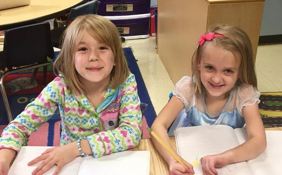 two dcg preschool students smiling